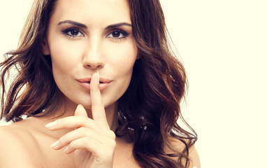 Woman with finger on lips, or secret gesture