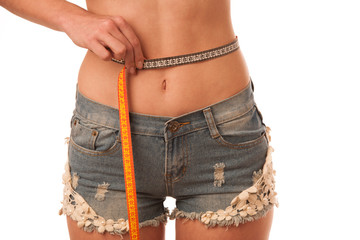 Healthy female body with apple and measuring tape. Healthy fitne