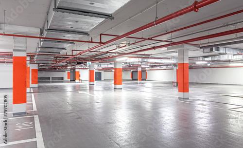 Photo of underground parking, industrial interior background.