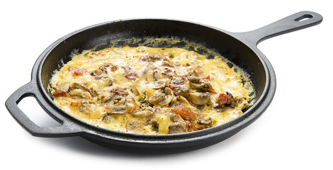 Homemade mushroom omlette in cast iron cooking pan