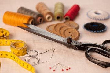 Vintage Background with sewing/Sewing kit. Scissors, bobbins wit