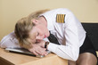 Leinwanddruck Bild - Tired female airline pilot wearing insignia of a captain
