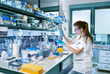 Young scientist works in modern laboratory - 79706804
