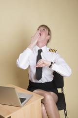 Tired female airline pilot wearing insignia of a captain