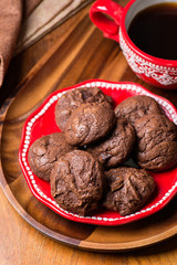 Homemade chocolate cookies on red plate