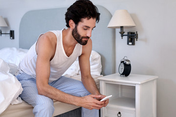 man cellphone bed