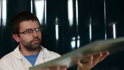 Scientist performing an  experiment in a quantum optics lab
