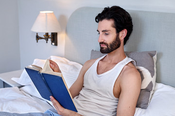 man book relaxing bed