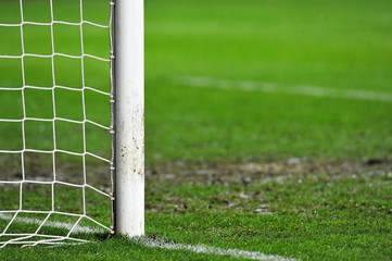 Soccer goal detail on rainy day
