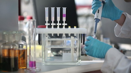 Researcher carrying out experiments in a chemistry laboratory