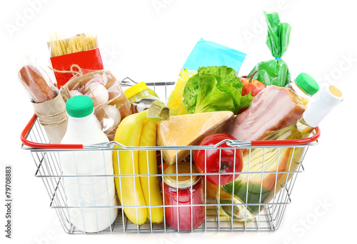 Metal shopping basket with groceries isolated on white - 79708883