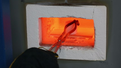 Metal being melted in a high temperature industrial oven