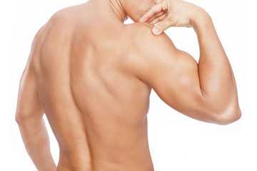 Muscular man with shoulder pain, isolated on white background