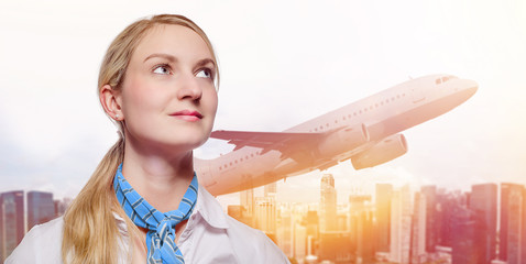 Young Stewardess in front of urban background