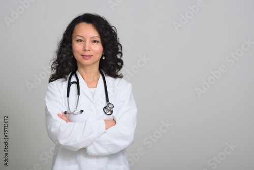 canvas print picture Asian female doctor with stethoscope