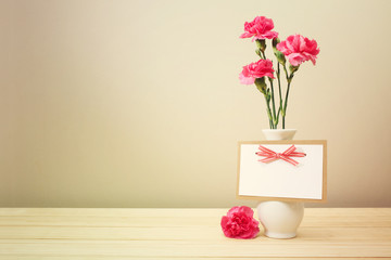 Pink Carnations on White Vase with Blank Greeting Card