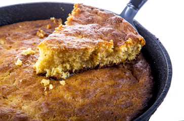 Serving Corn Bread in Cast-Iron Pan Isolated on White