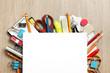 Leinwanddruck Bild - Blank paper on lots of office supplies
