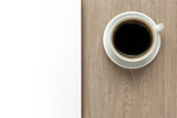Cup of coffee on office desk with white space