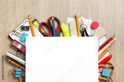 Leinwanddruck Bild Blank paper on lots of office supplies