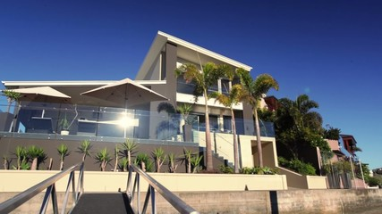 Panning shot of luxury waterfront home