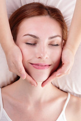 young woman enjoy face massage
