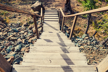 Wooden stairs on the hill leading down