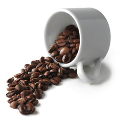 Spilled coffee beans from cup