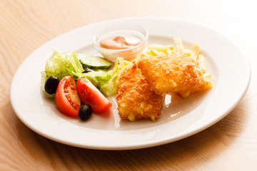 fried cheese with salad and potaotes