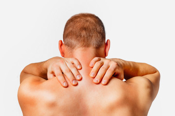 Pain in a male neck, rear view