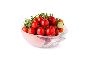 fresh cherry tomato with stem in bowl isolated on white backgrou