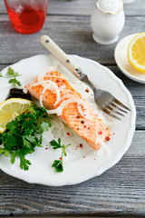Tasty salmon on a white plate