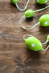 Easter garland on wooden surface