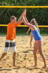 Freude beim Beachvolleyball