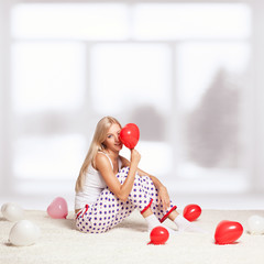 Blonde woman with balloons