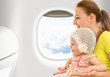 Airplane flight from inside. Woman and kid travelling together.
