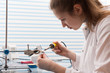 Girl Solder and adjust Electronic Device - 79720093