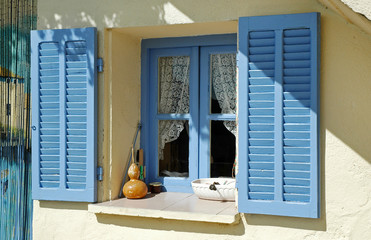 Opened blue window shutters