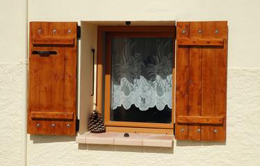 Opened wooden window shutters