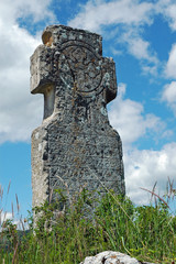 Abandoned stone cross landmark in the mountains