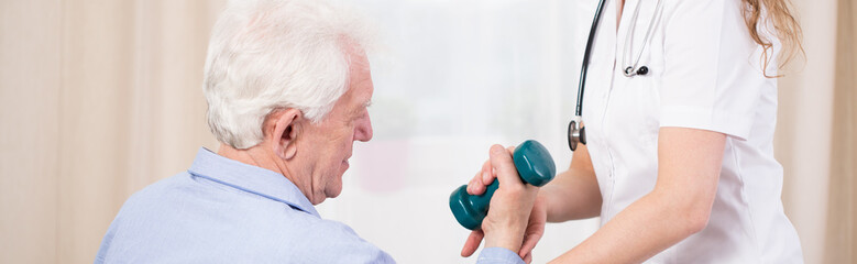 Elder patient training with dumbbell