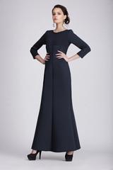 Studio Shot of Young Woman in Dark Dress