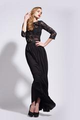 Elegant Luxurious Woman posing in Long Dress