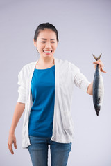 Vietnamese girl with a fish