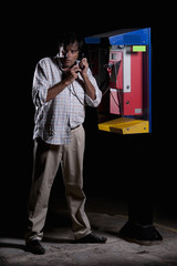 Desperate man, trying to speak in a telephone booth