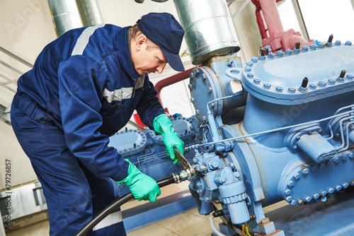 service worker at industrial compressor station - 79726857