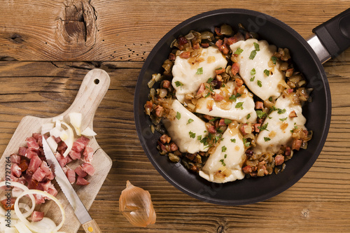Delicious homemade dumplings with onion and bacon - 79727264
