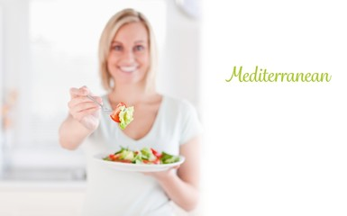 Mediterranean against woman offering salad