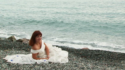 Pretty Woman Relaxing on Beach At Dull Day