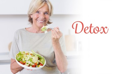 Detox against smiling woman eating salad